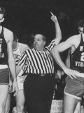 Referee Jim Enright Calling Plays and Using Hand Signals During a Game Reproduction photographique par Stan Wayman