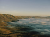 Fog over Ngorongoro Crater Photographic Print by Emory Kristof
