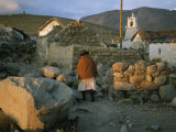 An Aymara Woman and Cat on a Path in an Atacama Desert Village Photographic Print by Joel Sartore