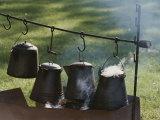 Four Metal Coffee Pots Steaming over an Outdoor Grill Valokuvavedos tekijänä Michael S. Lewis