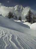 Mount Blanc Partially Obscured by Clouds in Snowy Landscape Photographic Print by Gordon Wiltsie