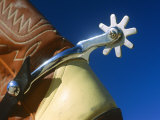 A Close-up of a Shiny Silver Spur on the Back of a Cowboy Boot Photographic Print by Todd Gipstein