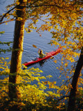 Woman Kayaking with Fall Foliage, Potomac River, Maryland Reproduction photographique par Skip Brown