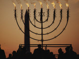 Silhouetted Worshippers Stand Before a Large Menorah Near the Washington Monument Photographic Print by Sam Kittner
