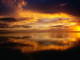 The Setting Sun Casts Light on Dark Clouds and Sea, Cook Islands Photographic Print by Peter Hendrie