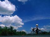 Women in Ao Dais on Bicycles, Vietnam Reproduction photographique par John Banagan