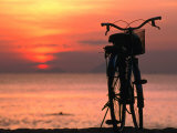 Bicycle Silhouetted Against Sunset on Nha Trang Beach, Nha Trang, Khanh Hoa, Vietnam Reproduction photographique par John Banagan