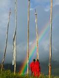 Rainbow and Monks with Praying Flags, Phobjikha Valley, Gangtey Village, Bhutan Photographic Print by Keren Su