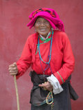 Elderly Tibetan Woman with Red Wall, Tagong, Sichuan, China Photographic Print by Keren Su