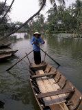Woman Rowing, Mekong Delta, Vietnam Reproduction photographique par Bill Bachmann