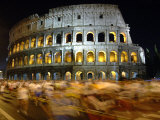 Runners Make Their Way Past the Colosseum in Rome Photographic Print