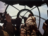 German Machine-Gunner in the Cockpit of a Bomber, Probably a Heinkel He-111 Lámina fotográfica por Unsere Wehrmacht