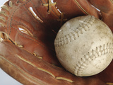 Beaten-Up Baseball in Baseball Glove Photographic Print