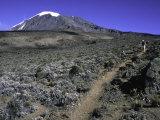 Hikers Moving Through a Rocky Area, Kilimanjaro Fotografisk trykk av Michael Brown