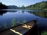 Canoe Resting on the Shore of Little Long Pond, Acadia National Park, Maine, USA Premium Photographic Print by Jerry & Marcy Monkman