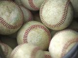 Gros plan sur des balles de baseball  Reproduction photographique