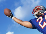 Low Angle View of An American Football Player Catching a Ball Lámina fotográfica