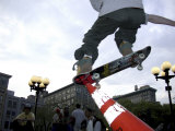 Skateboarder in Midair Knocking Over a Cone Fotografie-Druck