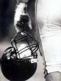 Low Angle View of An American Football Player Holding a Helmet Reproduction photographique
