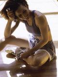 Exerciser Resting Holding Handweights Lámina fotográfica
