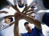 Low Angle View of Children of a Baseball Team in a Huddle Lámina fotográfica