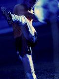 Soccer Player Kicking a Soccer Ball Lámina fotográfica