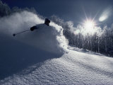 Skier in a Cloud of Snow with Sunburst Reproduction photographique