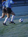 Two Teenage Girls Running for a Soccer Ball Lámina fotográfica