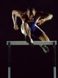 Portrait of a Young Man Jumping over a Hurdle Lámina fotográfica