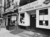 A Chinese Laundromat is Seen Next Door to the Offices of the Little Italy Restoration Association Photographic Print