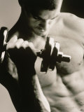 Close-up of a Young Man Working Out with a Dumbbell Reproduction photographique