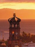 Tower of Nuestra Senora de Guadalupe at Sunset, and Bay of Banderas, Puerto Vallarta, Mexico Photographic Print by John & Lisa Merrill