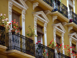 Spain, Sevilla, Andalucia Geraniums hang over iron balconies of traditional houses Photographic Print by John & Lisa Merrill