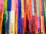 Colorful Silk Scarves at Edfu Market, Egypt Photographic Print by Michele Molinari
