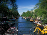 Yellow Bicycle and Canal, Amsterdam, Netherlands Reproduction photographique par Nik Wheeler
