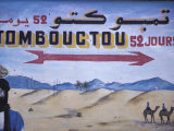 Colorful Sign Showing Way to Timbuktu, Morocco Photographic Print by John & Lisa Merrill