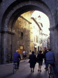 Pedestrians Entering Archway, Lucca, Italy Photographic Print by John & Lisa Merrill