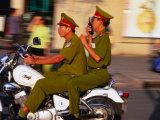 Policemen on Motorbike, Ho Chi Minh City, Vietnam Reproduction photographique par John Banagan
