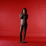Rock Star Jim Morrison of the Doors Holding Microphone Alone as He Stands Against a Red Backdrop Premium Photographic Print by Yale Joel