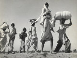Sikh Carrying His Wife on Shoulders After the Creation of Sikh and Hindu Section of Punjab India Reproduction photographique par Margaret Bourke-White
