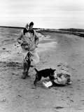 Jackie Kennedy, Wife of Sen, Walking Along Beach with Her Slicker Clad Daughter Caroline Photographic Print by Alfred Eisenstaedt