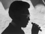 """Silhouette of Actor/Comedian Bill Cosby with Cigar, Former Star of TV Series """"I Spy"""" Premium Photographic Print by John Loengard"""