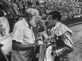 Spanish Matador Antonio Ordonez with Friend, Author Ernest Hemingway in Arena Before Bullfight Premium fototryk af Loomis Dean