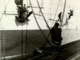 Painters Sitting on Rigging Clean and Paint Side of Ship During Spring Cleaning Photographic Print by J. Kauffmann