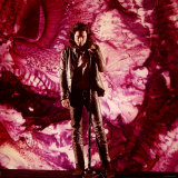 Rock Star Jim Morrison of The Doors Singing on Stage in Front of a Purple Psychedelic Backdrop Premium Photographic Print by Yale Joel