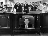 John F. Kennedy's TV Announcement of Cuban Blockade During the Missile Crisis in a Department Store Stretched Canvas Print by Ralph Crane