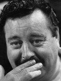 Actor Jackie Gleason Hiding His Mustache Impressão fotográfica premium por Robert W. Kelley