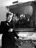 Evita Peron, Wife of Argentinean Presidential Candidate With. a Glass of Champagne in Her Apartment Premium Photographic Print by Thomas D. Mcavoy