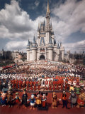 Walt Disney Characters and Park Staff Posing En Masse in Front of Cinderella's Castle Photographic Print by Yale Joel