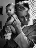 Blind Doctor Albert A. Nast Holding Ear to Back of 3 Month Old Instead of Using a Stethoscope Photographic Print by Thomas D. Mcavoy